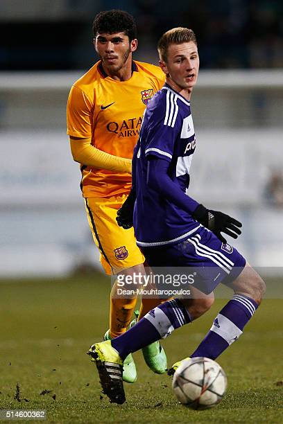 Siebe Van Der Heyden of Anderlecht is beaten by Carles Alena Castillo of Barcelona during the UEFA Youth League Quarterfinal match between Anderlecht...