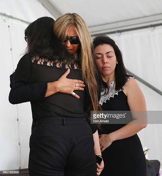 Siege victims Fiona Ma Selina Win Pe and Harriette Denny comfort each other at a wreath laying ceremony after the funeral for Tori Johnson at Martin...