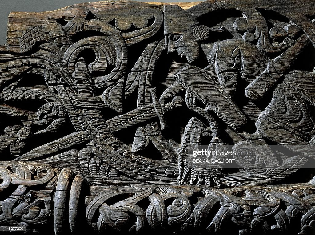 Siegfried killing the dragon detail from Stories of the Nordic Saga of Siegfried 12th Century Wooden doorway of the Stavkirke Hylestad in Norway Oslo...