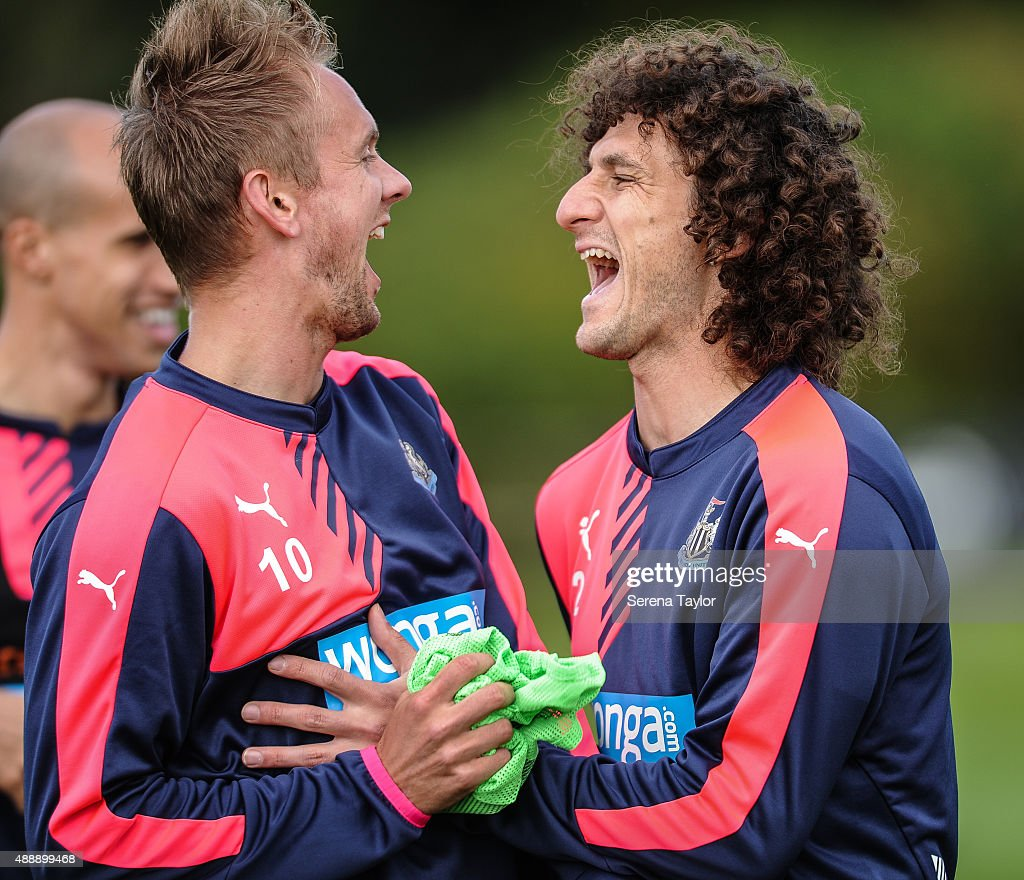 Siem de Jong (L) and Fabricio Coloccini (R) laugh during the Newcastle United Training session at The Newcastle United Training Centre on September 18, 2015, in Newcastle upon Tyne, England.