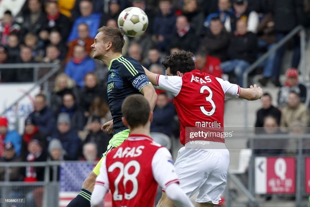 Siem de Jong of Ajax (L), Dirk Marcellis of AZ (R) during the Dutch Eredivisie match between AZ Alkmaar and Ajax Amsterdam at the AFAS Stadium on march 17, 2013 in Alkmaar, The Netherlands