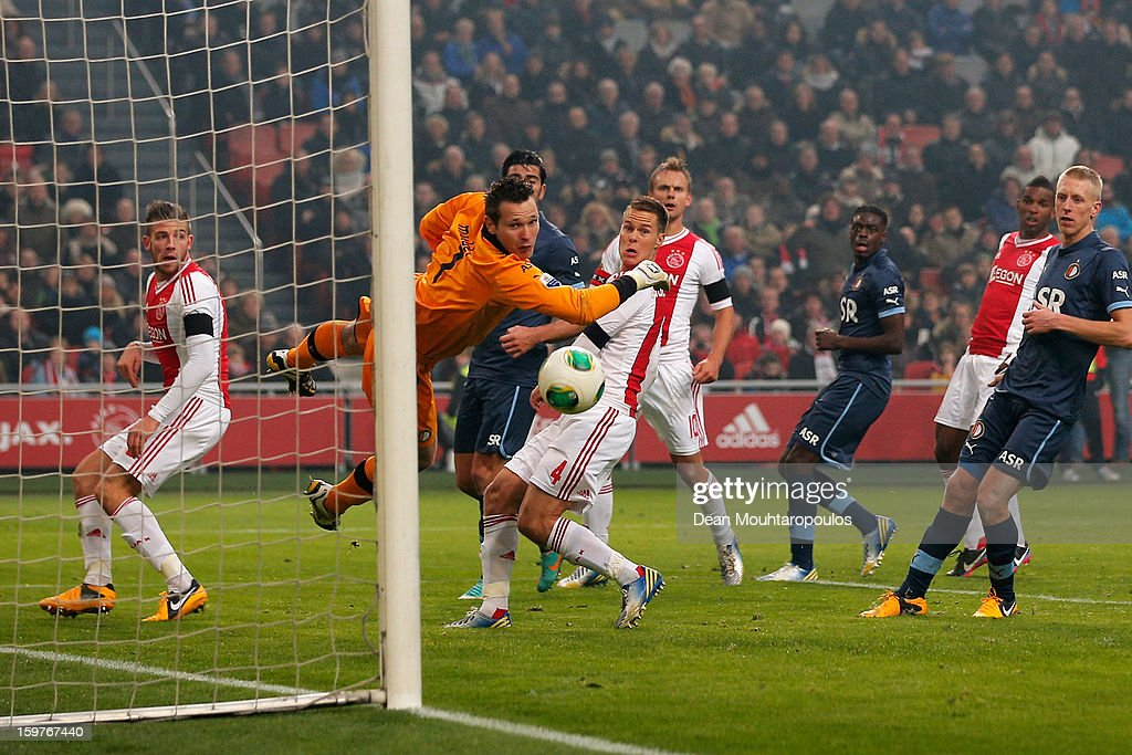 Siem De Jong (#10) of Ajax gets a touch on the ball to put the ball past goalkeeper, Erwin Mulder of Feyenoord during the Eredivisie match between Ajax Amsterdam and Feyenoord Rotterdam at Amsterdam Arena on January 20, 2013 in Amsterdam, Netherlands.