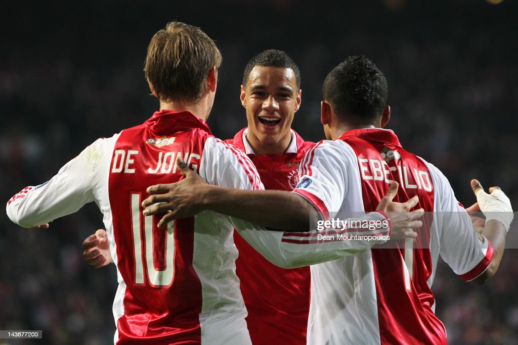 Siem de Jong (L) of Ajax is congratulated by team mates Gregory van der Wiel (C) and Lorenzo Ebecilio (R) after he scores the second goal of the game during the Eredivisie match between Ajax Amsterdam and VVV Venlo at Amsterdam Arena on May 2, 2012 in Amsterdam, Netherlands.