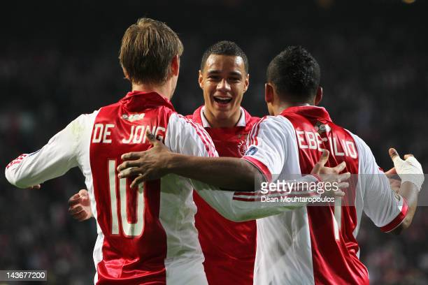 Siem de Jong of Ajax is congratulated by team mates Gregory van der Wiel and Lorenzo Ebecilio after he scores the second goal of the game during the...