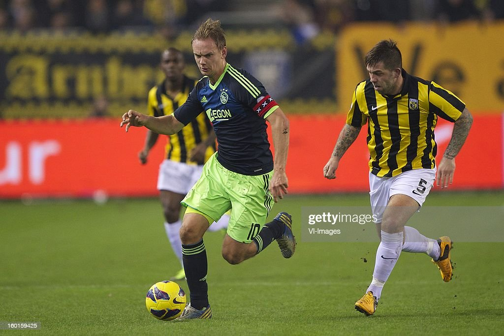 Siem de Jong of Ajax, Theo Janssen of Vitesse during the Dutch Eredivise match between Vitesse Arnhem and Ajax Amsterdam at the Gelredome on January 27, 2013 in Arnhem, The Netherlands.