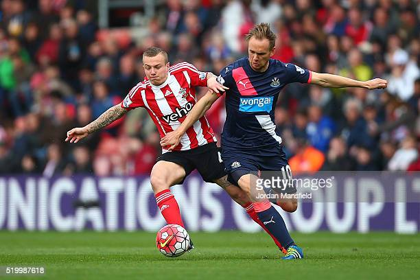 Siem de Jong of Newcastle United and Jordy Clasie of Southampton compete for the ball during the Barclays Premier League match between Southampton...