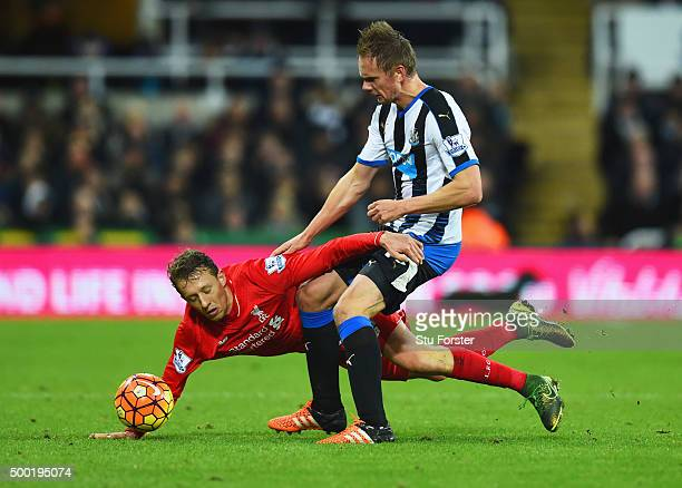Siem de Jong of Newcastle United tangles with Lucas Leiva of Liverpool during the Barclays Premier League match between Newcastle United and...
