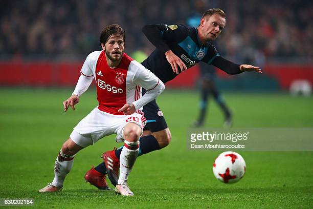 Siem de Jong of PSV battles for the ball with Lasse Schone of Ajax during the Eredivisie match between Ajax Amsterdam and PSV Eindhoven held at...