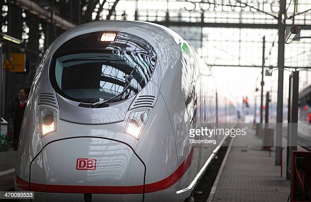 A Siemens AG 407 series InterCity Express 3 VelaroD train operated by Deutsche Bahn AG sits on a platform at the central railway station in Frankfurt...
