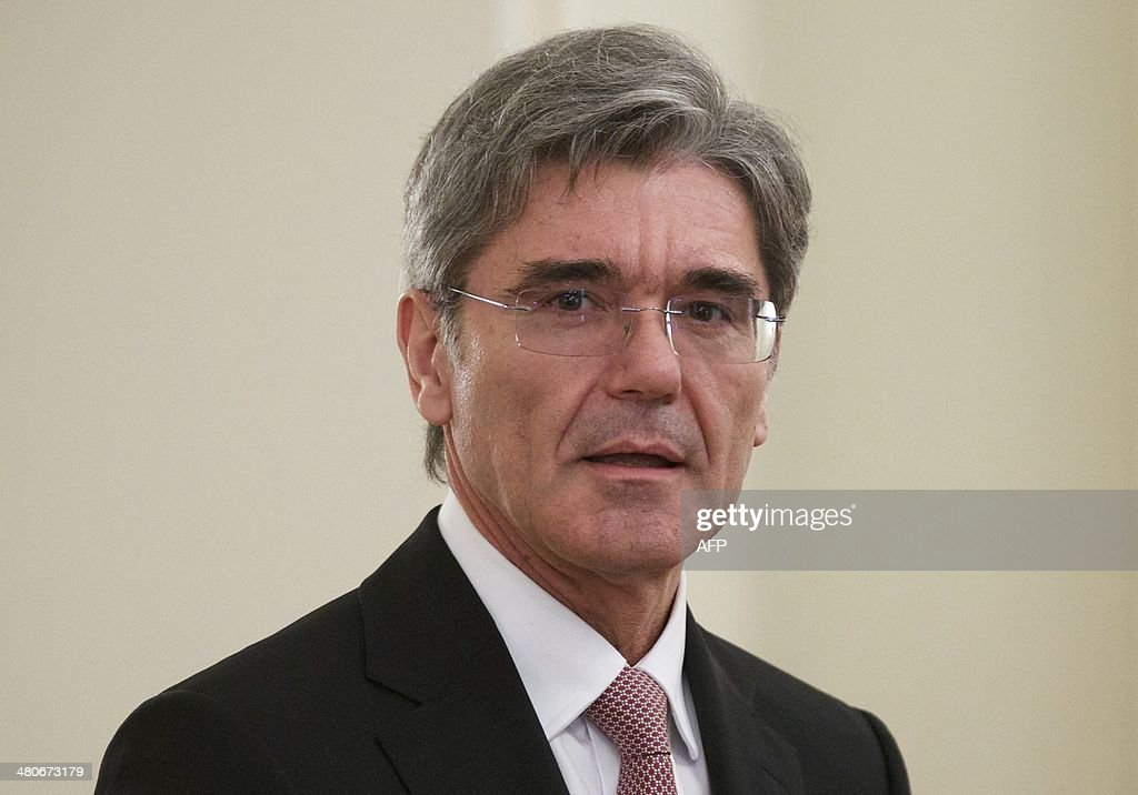 Siemens AG CEO, Joe Kaeser attends a meeting with Russia's President Vladimir Putin in the Novo-Ogaryovo residence outside Moscow, on March 26, 2014.