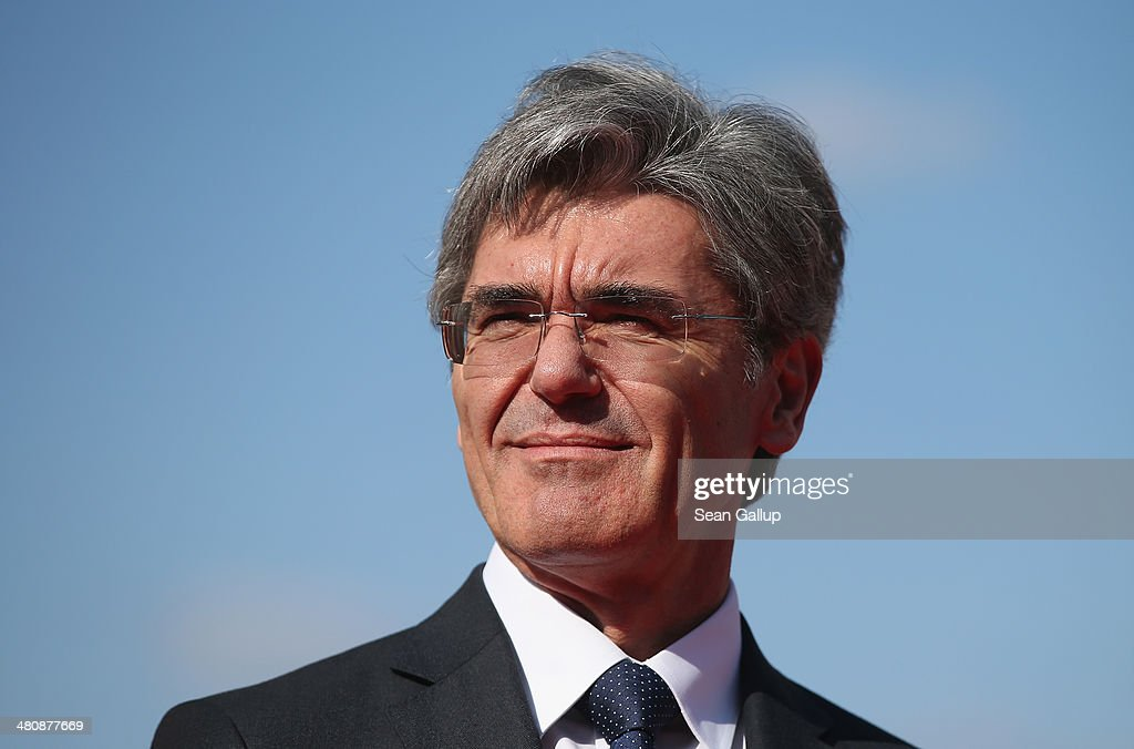 Siemens AG CEO <a gi-track='captionPersonalityLinkClicked' href=/galleries/search?phrase=Joe+Kaeser&family=editorial&specificpeople=558326 ng-click='$event.stopPropagation()'>Joe Kaeser</a> waits for the arrival of South Korean President Park Geun-hye at the Siemens gas turbine factory on March 27, 2014 in Berlin, Germany. President Park is on a two-day visit to the German capital.