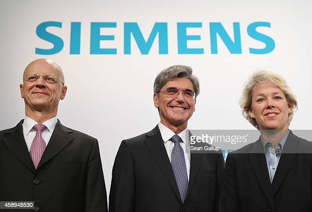 Siemens CEO Joe Kaeser CFO Ralf Thomas and board member Lisa Davis who heads the Siemens energy division pose for photographers moments before the...