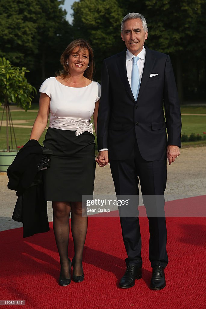 Siemens CEO <a gi-track='captionPersonalityLinkClicked' href=/galleries/search?phrase=Peter+Loescher&family=editorial&specificpeople=4296846 ng-click='$event.stopPropagation()'>Peter Loescher</a> and his wife Marta attend the dinner given in honour of U.S. President Barack Obama at the Orangerie of Schloss Charlottenburg palace on June 19, 2013 in Berlin, Germany. Obama is visiting Berlin for the first time during his presidency and his speech at the Brandenburg Gate is to be the highlight. Obama will be speaking close to the 50th anniversary of the historic speech by then U.S. President John F. Kennedy in Berlin in 1963, during which he proclaimed the famous sentence: 'Ich bin ein Berliner.'