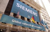 A 'Siemens' sign hangs in front of the New York Stock Exchange March 12 2001 in New York City Siemen's AG the Munichbased engineering and electronics...