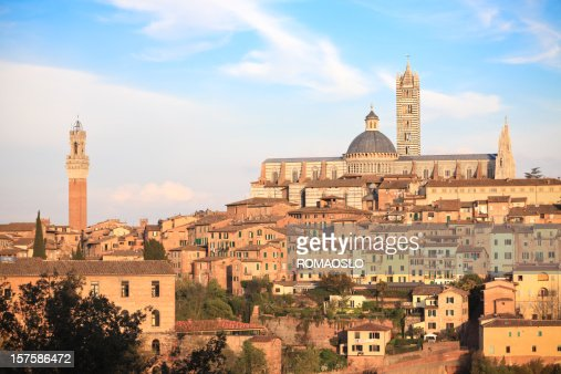 Siena Cathedral, Palazzo Pubblico and cityscape at sunset, Tuscany Italy