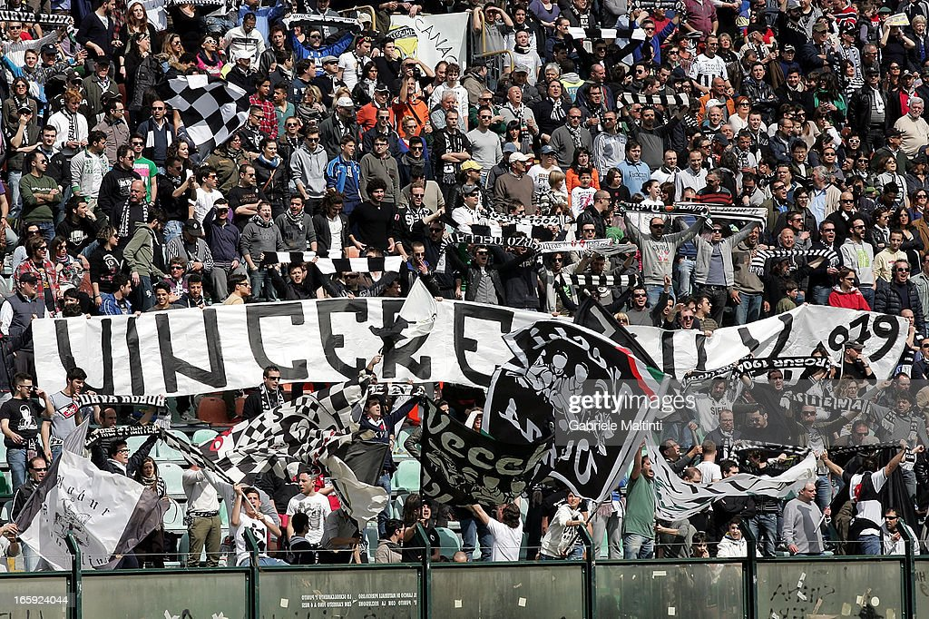 AC Siena fans show their support during the Serie A match between AC Siena and Parma FC at Stadio Artemio Franchi on April 7, 2013 in Siena, Italy.