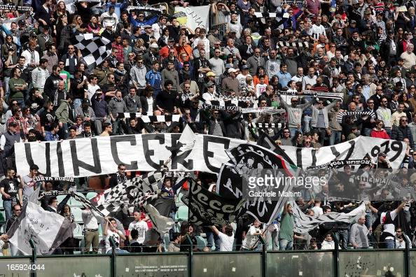 Siena fans show their support during the Serie A match between AC Siena and Parma FC at Stadio Artemio Franchi on April 7 2013 in Siena Italy