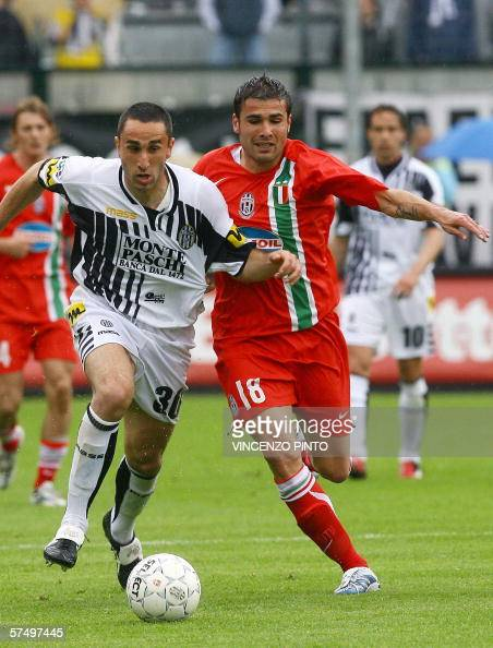 Juventus' Adrian Mutu figths for the ball with Gristian Molinaro of Siena during their Italian Serie A soccer match at Artemio Franchi stadium in...