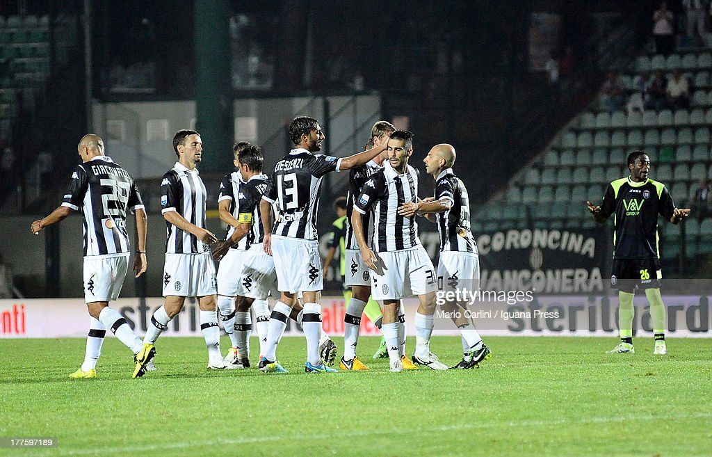 AC Siena players celebrate at the end of the Serie B match between AC Siena and FC Crotone at Stadio Artemio Franchi on August 24, 2013 in Siena, Italy.