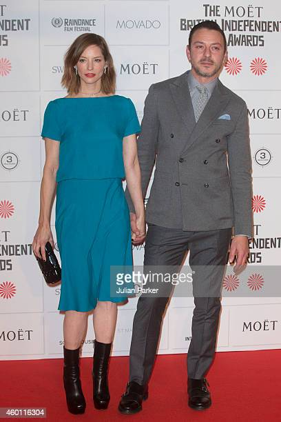 Sienna Guillory and Enzo Cilenti attends the Moet British Independent Film Awards at Old Billingsgate Market on December 7 2014 in London England