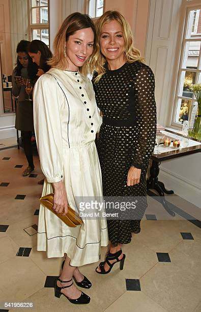 Sienna Guillory and Sienna Miller attend the launch of Wendy Rowe's new book 'Eat Beautiful' hosted by Sienna Miller at Burberry's all day cafe...