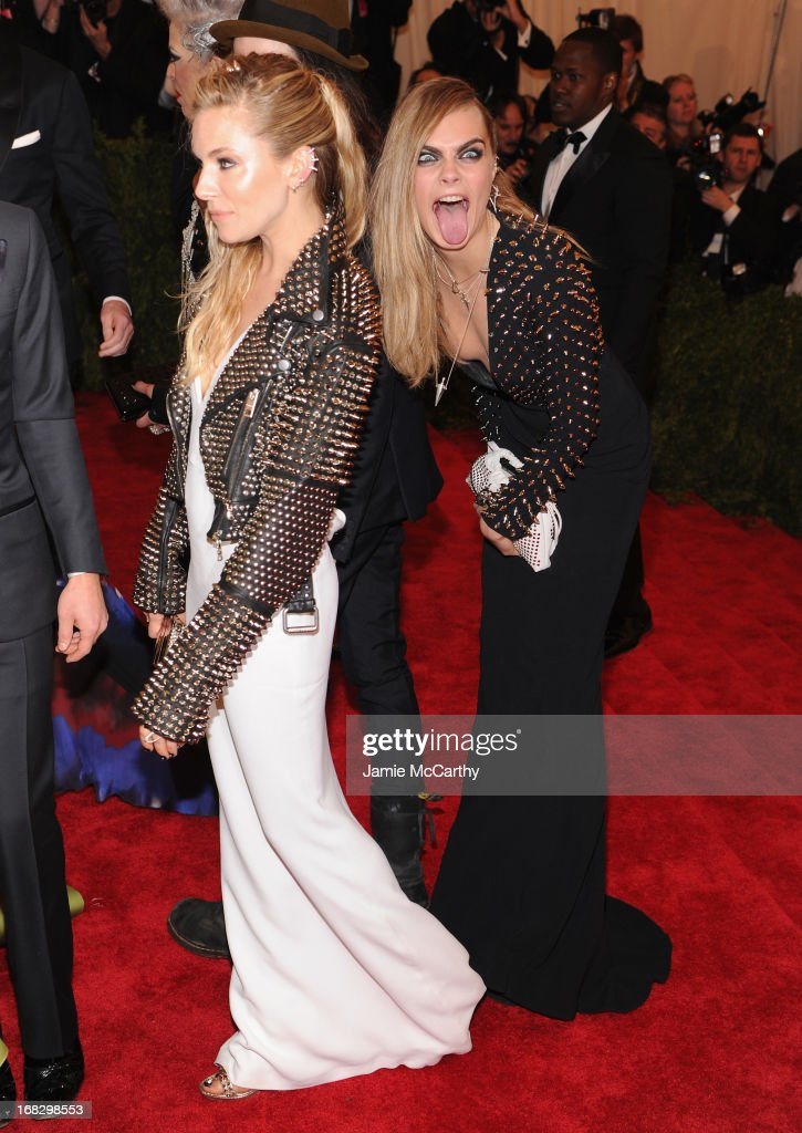Sienna Miller (L) and Cara Delevingne attend the Costume Institute Gala for the 'PUNK: Chaos to Couture' exhibition at the Metropolitan Museum of Art on May 6, 2013 in New York City.