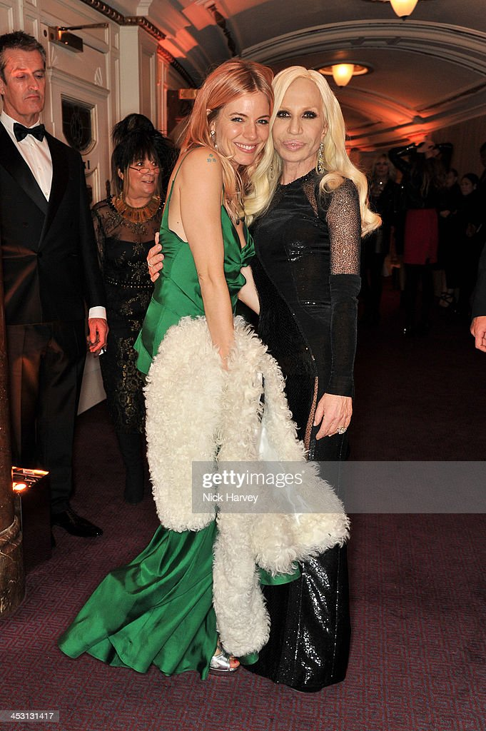 <a gi-track='captionPersonalityLinkClicked' href=/galleries/search?phrase=Sienna+Miller&family=editorial&specificpeople=171883 ng-click='$event.stopPropagation()'>Sienna Miller</a> and Donatella Versace attend the British Fashion Awards 2013 at London Coliseum on December 2, 2013 in London, England.