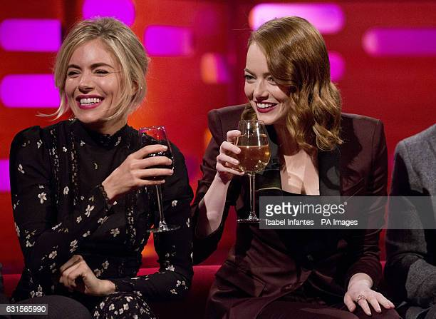 Sienna Miller and Emma Stone during filming of the Graham Norton Show at The London Studios south London to be aired on BBC One on Friday PRESS...