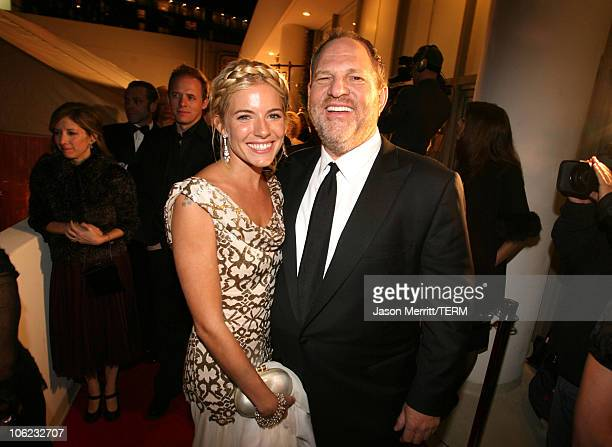 Sienna Miller and Harvey Weinstein during The Weinstein Co Golden Globe After Party at The Beverly Hilton Hotel in Beverly Hills California United...