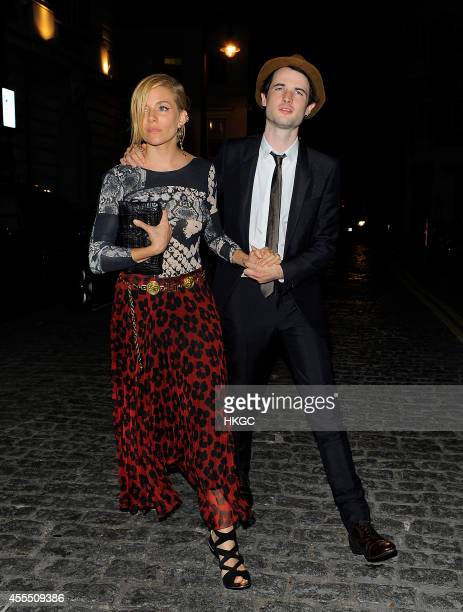 Sienna Miller and her Husband Tom Sturridge leave Lou Lou's Member's club after AnOther's Magazine party on September 15 2014 in London England