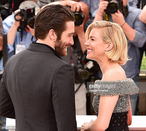 Sienna Miller and Jake Gyllenhaal attend the Jury photocall during the 68th annual Cannes Film Festival on May 13 2015 in Cannes France
