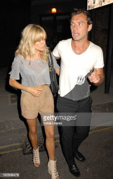 Sienna Miller and Jude Law attend The Dead Weather Gig held at the Roundhouse on June 28 2010 in London England