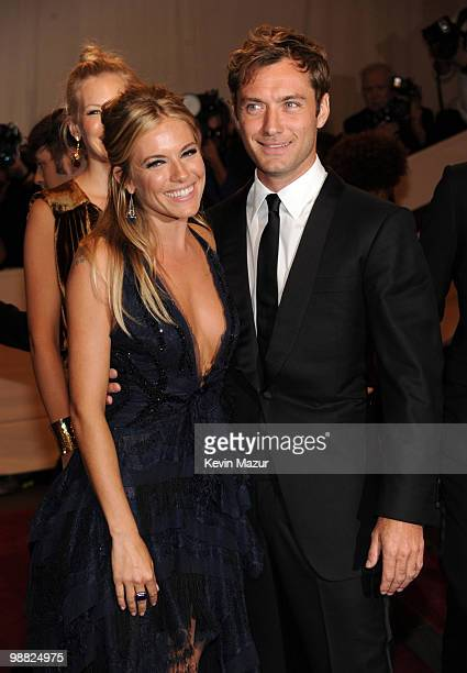 Sienna Miller and Jude Law attends the Costume Institute Gala Benefit to celebrate the opening of the 'American Woman Fashioning a National Identity'...