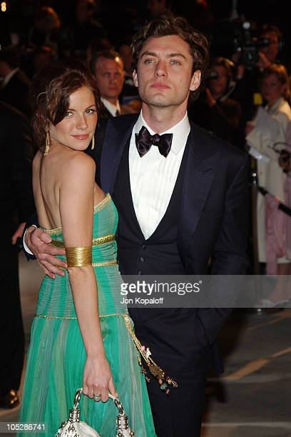 Sienna Miller and Jude Law during 2004 Vanity Fair Oscar Party at Mortons in Beverly Hills California United States