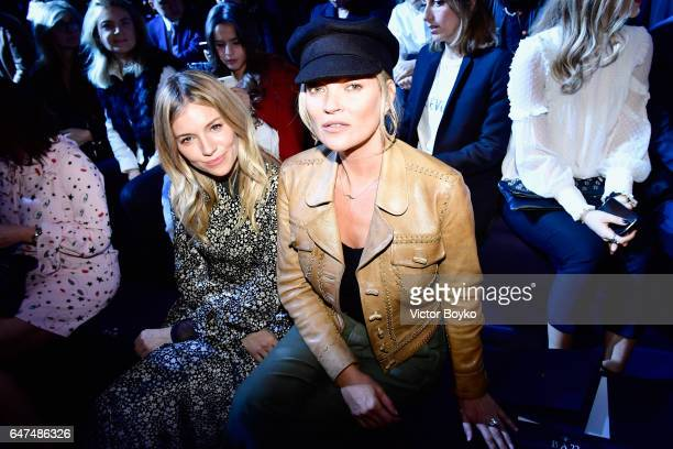 Sienna Miller and Kate Moss attend the Christian Dior show as part of the Paris Fashion Week Womenswear Fall/Winter 2017/2018 on March 3 2017 in...