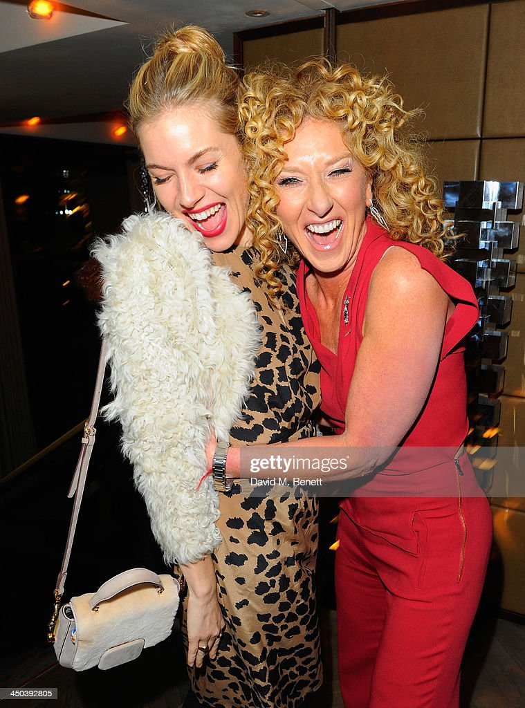 <a gi-track='captionPersonalityLinkClicked' href=/galleries/search?phrase=Sienna+Miller&family=editorial&specificpeople=171883 ng-click='$event.stopPropagation()'>Sienna Miller</a> and <a gi-track='captionPersonalityLinkClicked' href=/galleries/search?phrase=Kelly+Hoppen&family=editorial&specificpeople=214726 ng-click='$event.stopPropagation()'>Kelly Hoppen</a> attend the launch of <a gi-track='captionPersonalityLinkClicked' href=/galleries/search?phrase=Kelly+Hoppen&family=editorial&specificpeople=214726 ng-click='$event.stopPropagation()'>Kelly Hoppen</a> MBE's new book Design Masterclass at Belgraves Hotel on November 18, 2013 in London, England.