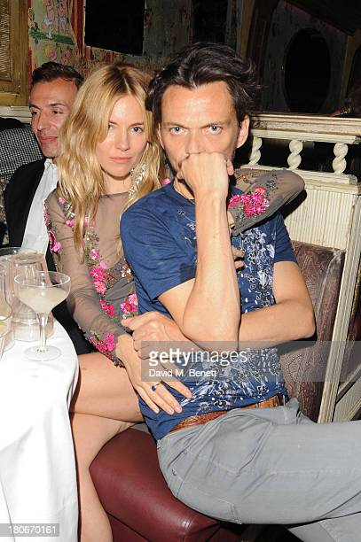 Sienna Miller and Matthew Wiliamson attend the Matthew Williamson after party during London Fashion Week SS14 at The Box Soho on September 15 2013 in...