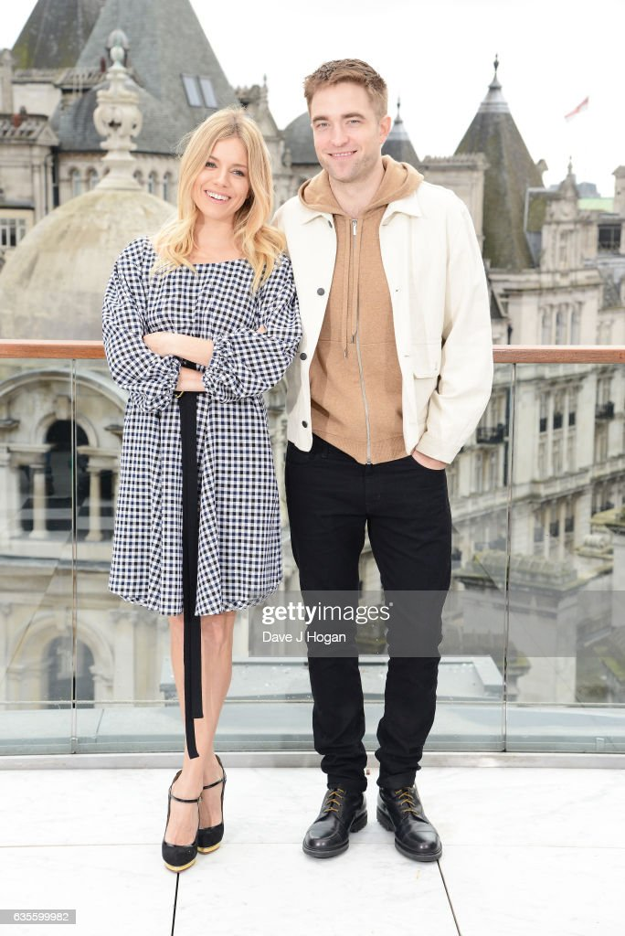Sienna Miller and Robert Pattinson pose at a photocall for 'The Lost City Of Z' at Corinthia London on February 16, 2017 in London, England.