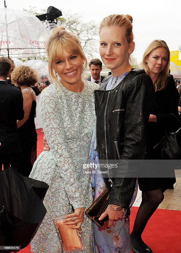 Sienna Miller (L) and sister Savannah attend the Arqiva British Academy Television Awards 2013 at the Royal Festival Hall on May 12, 2013 in London, England.