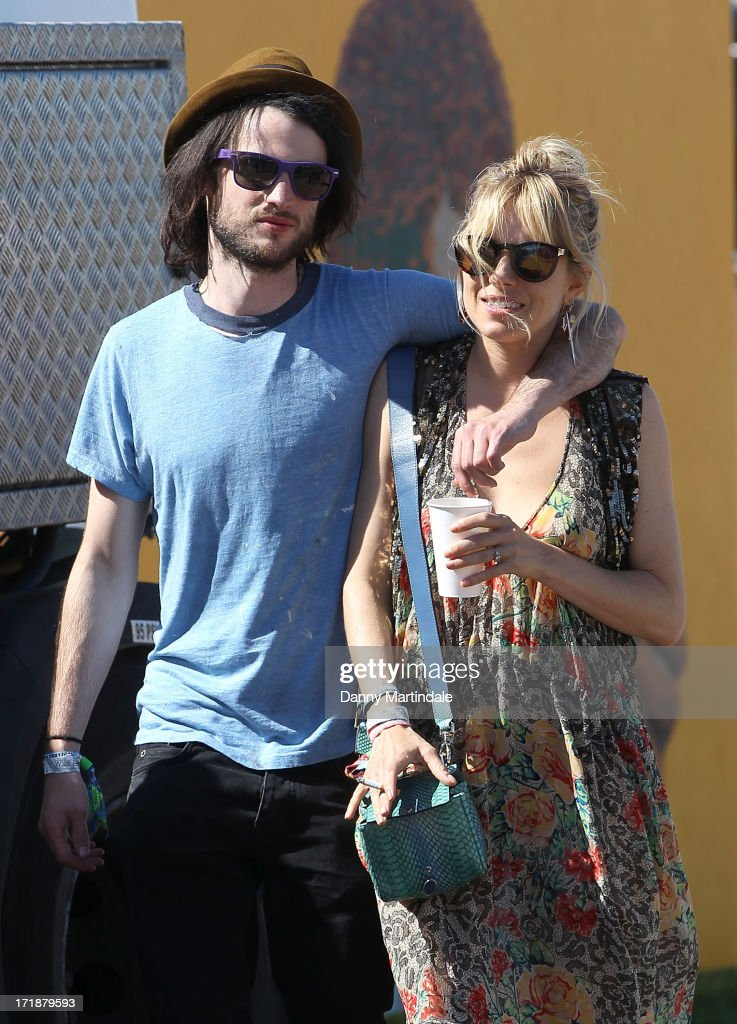 <a gi-track='captionPersonalityLinkClicked' href=/galleries/search?phrase=Sienna+Miller&family=editorial&specificpeople=171883 ng-click='$event.stopPropagation()'>Sienna Miller</a> and <a gi-track='captionPersonalityLinkClicked' href=/galleries/search?phrase=Tom+Sturridge&family=editorial&specificpeople=2666406 ng-click='$event.stopPropagation()'>Tom Sturridge</a> attend day 3 of the 2013 Glastonbury Festival at Worthy Farm on June 29, 2013 in Glastonbury, England.
