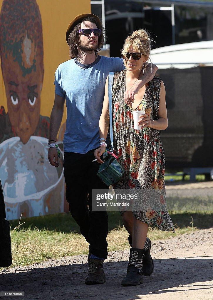 Sienna Miller and Tom Sturridge attend day 3 of the 2013 Glastonbury Festival at Worthy Farm on June 29, 2013 in Glastonbury, England.