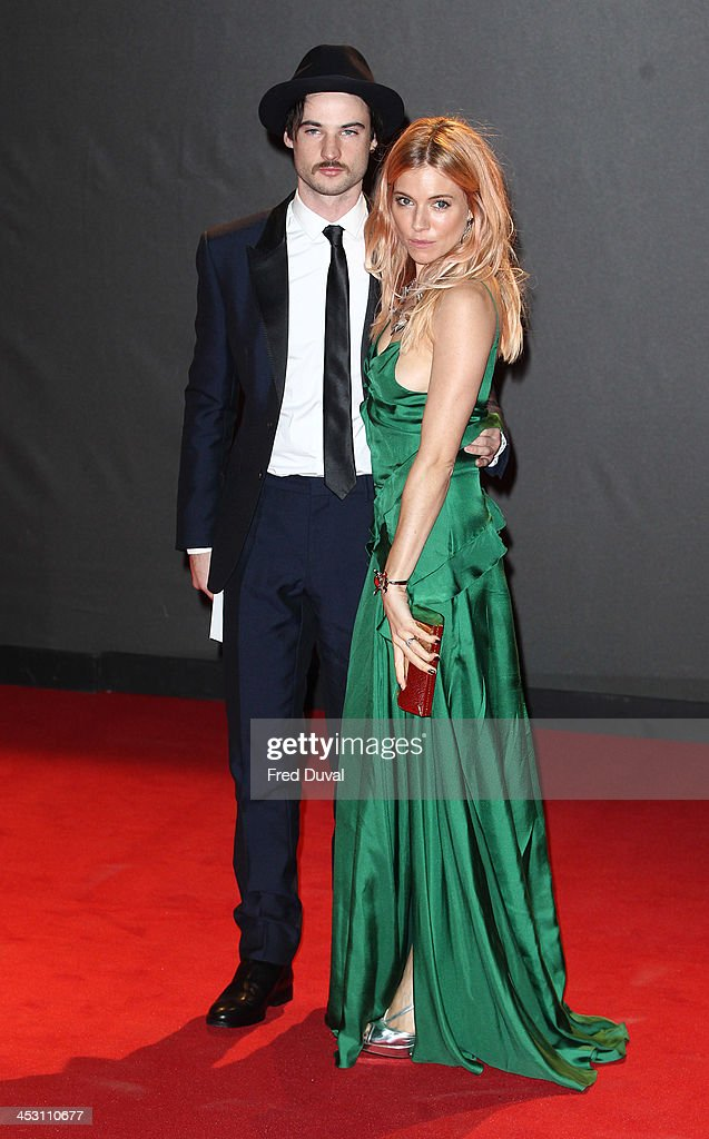 Sienna Miller and Tom Sturridge attend the British Fashion Awards 2013 at London Coliseum on December 2, 2013 in London, England.