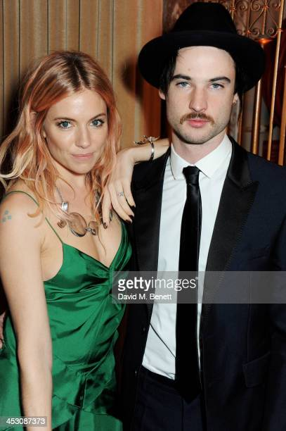 Sienna Miller and Tom Sturridge attend the British Fashion Awards 2013 drinks reception at the London Coliseum on December 2 2013 in London England