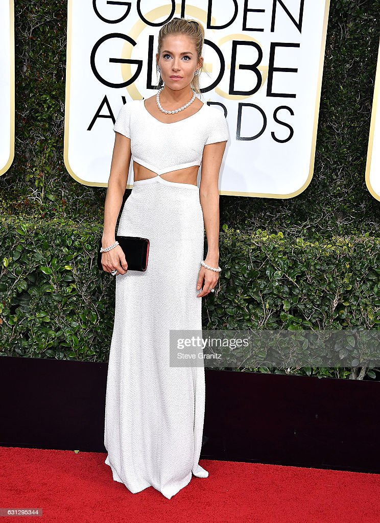 sienna-miller-arrives-at-the-74th-annual-golden-globe-awards-at-the-picture-id631295344