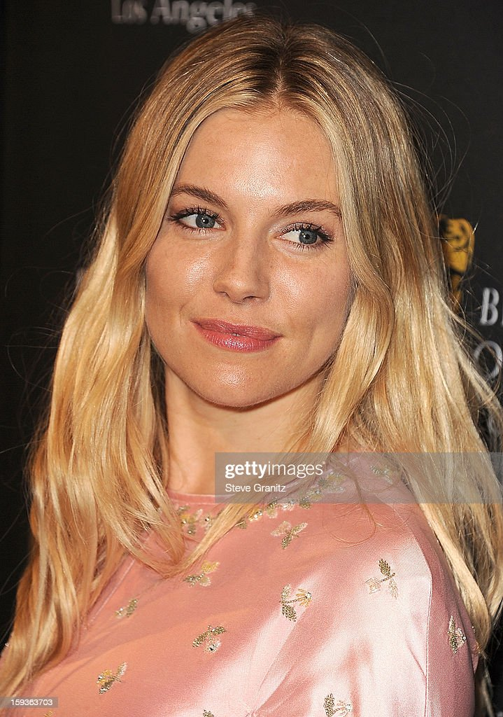 <a gi-track='captionPersonalityLinkClicked' href=/galleries/search?phrase=Sienna+Miller&family=editorial&specificpeople=171883 ng-click='$event.stopPropagation()'>Sienna Miller</a> arrives at the BAFTA Los Angeles 2013 Awards Season Tea Party at Four Seasons Hotel Los Angeles at Beverly Hills on January 12, 2013 in Beverly Hills, California.