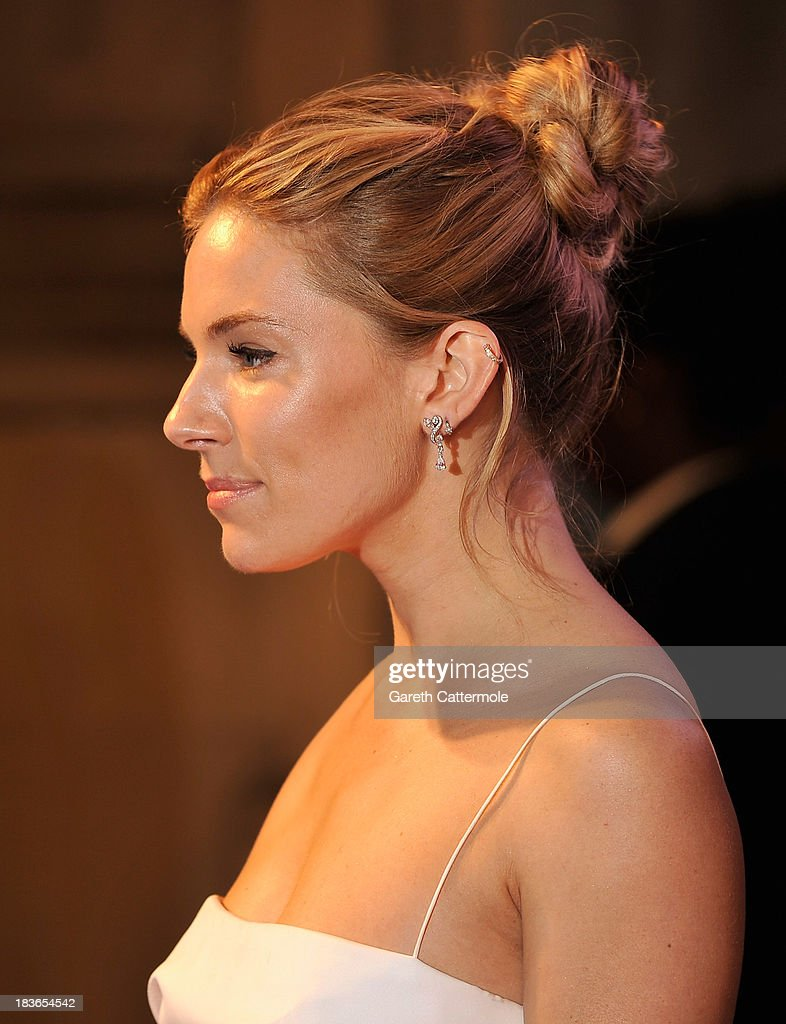 Sienna Miller attends a gala dinner hosted by the BFI ahead of the 57th London Film Festival at 8 Northumberland Avenue on October 8, 2013 in London, England.