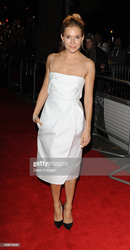<a gi-track='captionPersonalityLinkClicked' href=/galleries/search?phrase=Sienna+Miller&family=editorial&specificpeople=171883 ng-click='$event.stopPropagation()'>Sienna Miller</a> attends BFI Gala Dinner on October 8, 2013 in London, England.
