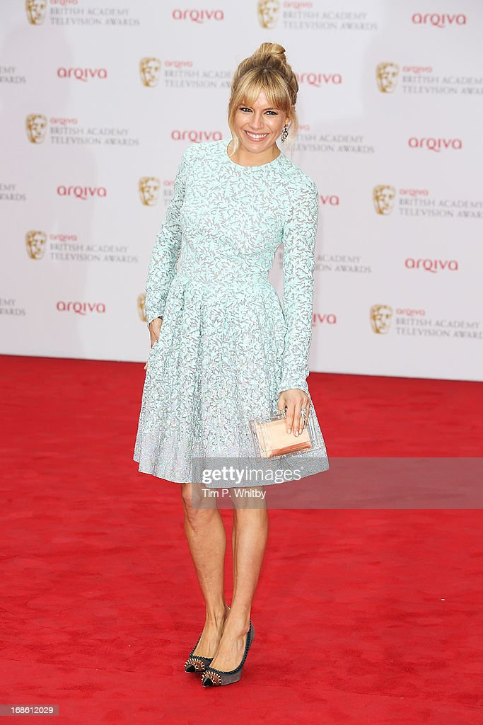 <a gi-track='captionPersonalityLinkClicked' href=/galleries/search?phrase=Sienna+Miller&family=editorial&specificpeople=171883 ng-click='$event.stopPropagation()'>Sienna Miller</a> attends the Arqiva British Academy Television Awards 2013 at the Royal Festival Hall on May 12, 2013 in London, England.