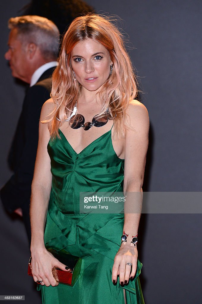 <a gi-track='captionPersonalityLinkClicked' href=/galleries/search?phrase=Sienna+Miller&family=editorial&specificpeople=171883 ng-click='$event.stopPropagation()'>Sienna Miller</a> attends the British Fashion Awards 2013 held at the London Coliseum on December 2, 2013 in London, England.