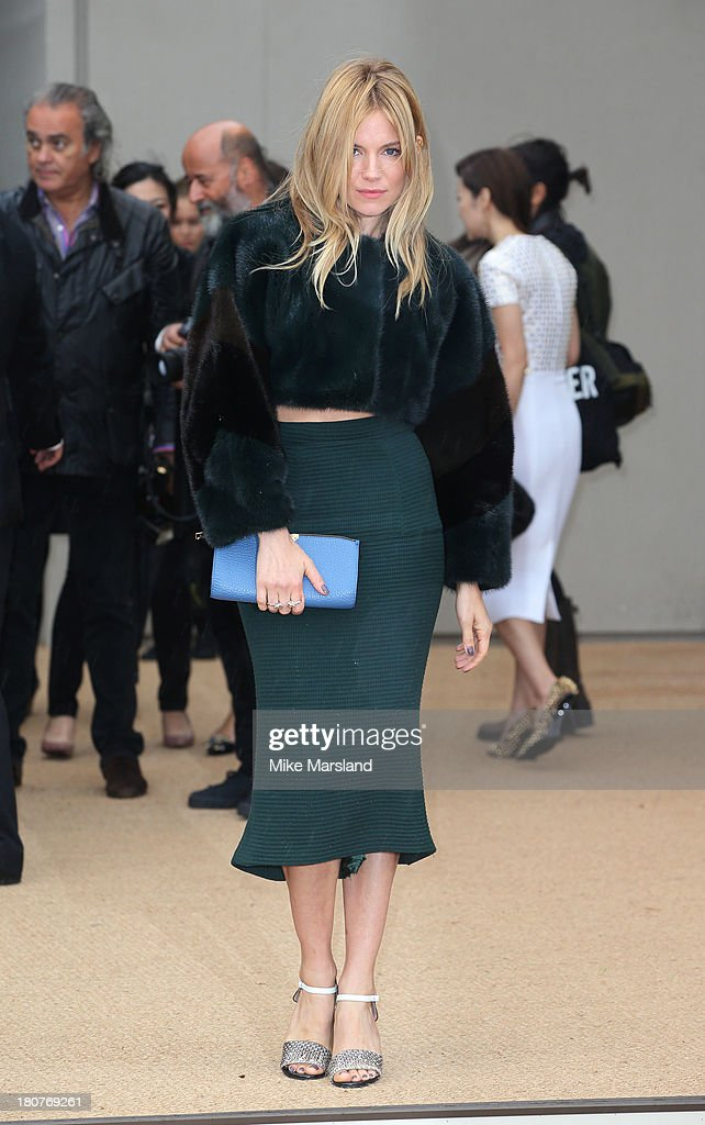 Sienna Miller attends the Burberry Prorsum show during London Fashion Week SS14 at on September 16, 2013 in London, England.